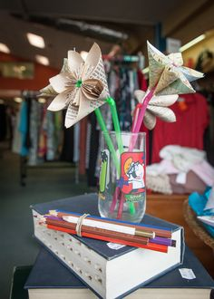 Flowers made out of book pages and straws!