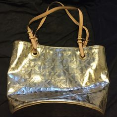 Michael Kors  medium sized purse used Gently used MK Gold Purse, paid $399.99 for this purse 6 months ago! Has some makeup stains on the inside and normal wear on inside, outside is in perfect condition! Very Beautiful gold color Michael Kors Bags Shoulder Bags