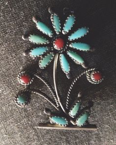 Vintage Zuni flower pendant with turquoise and coral