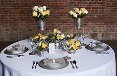 Modern, industrial wedding details & centerpieces. Yellow & metallic silver. Images by Amber Reinink Photography.