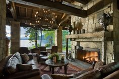 Bring the indoors out by adding an outdoor living space to your home! From simple firepits to full on kitchens and cozy fireplaces, these outdoor living design ideas are sure to impress. Outdoor Rooms, Outdoor Living, Indoor Outdoor, Outdoor Patios, Rustic Patio, Log Home Decorating, Home Porch, Cozy Fireplace, Fireplace Design