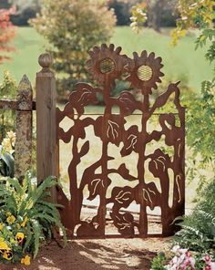 Sunflower garden gate... I'm going to try making a similar gate from multiple layers of plywood, giving it a 3-D effect.