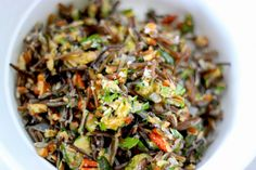 TRIED and LOVED:  Have wanted to make this for a long time.  Wild rice salad w/ proper zucchini.  So delicious.  Left out the cheese.  Wonderful nutty flavor from the pecans and delicate lemon notes.  Needed to double the recipe, however, and maybe cut down on the oil.  Works just as well in a pan.