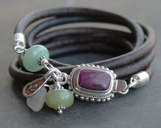 a8b4fed28fe9 Multi-wrap pearl and Leather bracelet with bright peacock pearls and silver  charms. A