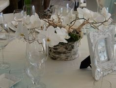 A sculptural centerpiece featuring bark, branches, balsa wood flowers and crystal detailing for a St. Barth's wedding designed by Alchemy Fine Events  www.alchemyfineevents.com