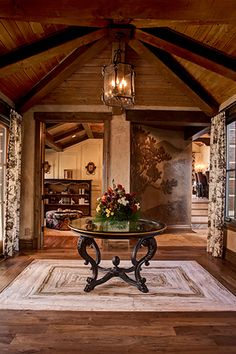 Love the feature wall with the tress and hills but not sure we have a spot for it.  Nice beams and wood ceiling.