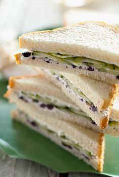 The Deen Bros Cucumber, Vidalia Onion, and Cream Cheese Sandwiches  2 ounces cream cheese, softened  1/4 cup chopped, pitted kalamata olives  1/2 teaspoon freshly ground black pepper  8 slices white bread, crusts removed if desired  1 medium cucumber, thinly sliced  1 small Vidalia onion, thinly sliced