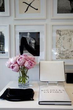 peonies and a black and white gallery wall