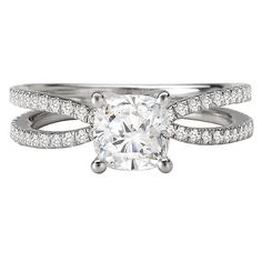 This classic diamond engagement ring features a split shank accented by 0.25 carats total weight of round briliant diamonds. G/H color, SI clarity. Fits a 5.5-6.0 MM Cushion cut or 5.5 MM Princess cut center diamond (SOLD SEPARATELY). Matching wedding band available.