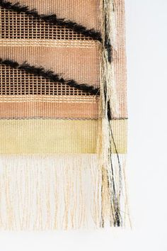 """Hand-loomed wall tapestry in metallic threads. Gold and copper metals with black thread accents. Black and gold fringing through weave. Gold fringe at bottom. Inspired by traditional Navajo wall tapestries depicting mountains and landscapes. Made in UK. Can be hung alone or as part of a series. Weaving Length 17"""", Weaving Width 10"""", Fringing Length 3½"""". Inspired by notions of cosmos, alchemy, and sacred experience, Native Line incorporates indigenous crafts into new and luminou..."""
