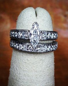 White gold and diamond marquise engagement ring and band
