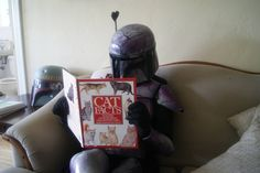 Boba Fett reads a book about cats