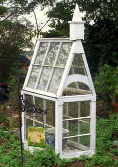 Too cute use of old windows - a small garden conservatory...