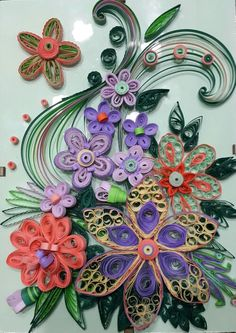 Quilling flower arrangement by ♧ The Quilling Fairies ♧ by Eliane Tanassi - Facebook - (Paper quilling on a glass frame )
