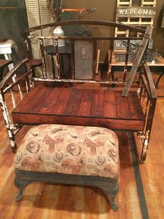Re-Scape: BizScape from Jody of Junk & Disorderly bed frame from the 1800's for the bench and an old stove base got the ottoman!