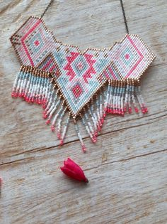 Handmade brick stitch necklace pinks blue and white by CloByClea                                                                                                                                                                                 More