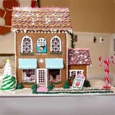 A first gingerbread house-making attempt by Beverly C. of Grand Junction, CO, this Cake Bakery was created using an X-Acto knife to trim the windows, a jigsaw for the base, and a brick impression mat on the walls. | thisoldhouse.com