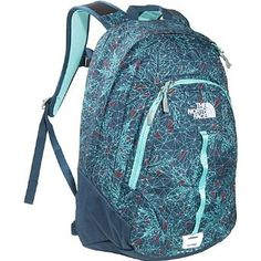 The North Face Women's Vault Kodiak Blue Geo Snowflake Backpack Bookbag.             The North Face has done it again with this classic 26-liter Women's Vault. Iron-clad design features a large main zip compartment that accommodates books and binders, with a secondary zip compartment that features internal organization to keep you in-check. External lash p...