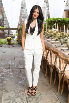 7 Events, 18 Weekend Outfit Ideas #refinery29  http://www.refinery29.com/new-york-city-party-style#slide-12  A white vest, lacy black top, and white pants make an ideal weekend (or dinner-party) look.