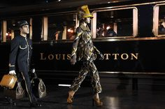 Louis Vuitton Fall Winter 2012/13 Paris Fashion Week by Marc Jacobs! It looks superb, a life-sized train with models hopping out with their personal porters holding LV luggage.