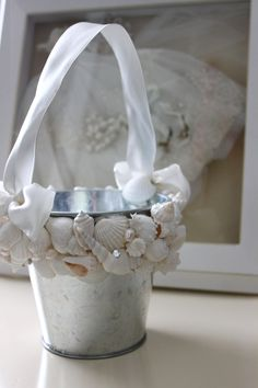 Seashell Flower Girl Pail - Beach Wedding. $28.00, via Etsy.  Could totally make it with shells from the craft store, hot glue, and scrap of fabric.