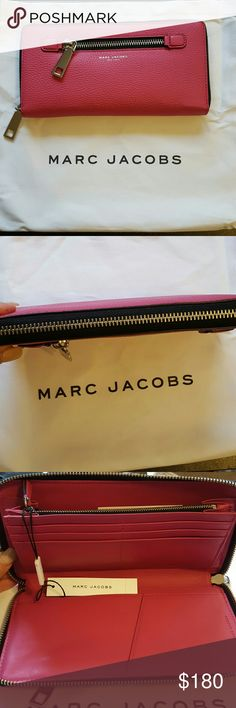 NWT Marc Jacobs Gotham City Slgs Travel Wallet NWT Marc Jacobs Gotham City Slgs Travel Wallet Beautiful over sized wallet almost clutch size Pretty Strawberry Pink Color. Outside zipper pocket. Inside also has a zippered pocket with plenty of card slots and open pockets and pen holder. Comes with dust bag and care card. Marc Jacobs Bags Wallets