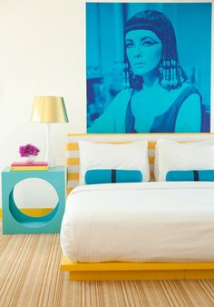 """Sneak Peek: Best of Turquoise. """"This hotel room at The Lords in Miami goes all out with turquoise on the pillows, side table and this fabulous portrait of Elizabeth Taylor."""" #sneakpeek #turquoise"""