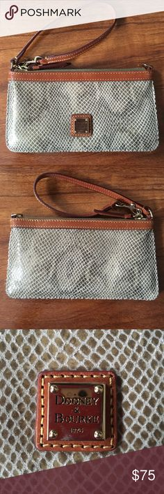 Dooney and Bourke Gold Snakeskin Wristlet Never been used. Perfect condition. Subtle shimmer to the gold snakeskin print, with leather trim/wrist strap. Red interior with compartment divider. Dooney & Bourke Bags Clutches & Wristlets