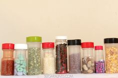 Create sensory bottles for visual and auditory sensory play for babies and toddlers using a variety of materials and recycled spice containers.