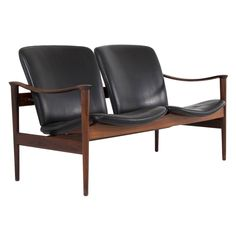 Rosewood and Black Leather Two-Seater by Fredrik Kayser, Norway 1950's | From a unique collection of antique and modern loveseats at https://www.1stdibs.com/furniture/seating/loveseats/
