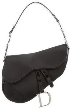 Christian Dior Leather-Trimmed Saddle Shoulder Bag  https://api.shopstyle.com/action/apiVisitRetailer?id=611861622&pid=uid2500-37484350-28