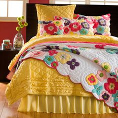Add a pop of color to your bedding with this colorful flower quilt and shams. These eye-catching bed coverings are made of soft 100-percent cotton and are machine washable for your convenience. Each of these Kamila GIrl items are sold separately.