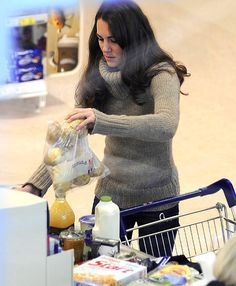 Wearing a thick turtleneck, Duchess Kate stocked up on essentials at the grocery store Tuesday. Prince William's wife bought bananas, chicken, milk, potatoes, oranges, cereal, Haagen-Dazs ice cream, lettuce.
