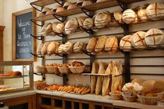 Le Pain Quotidien, a Belgian-inspired bakery is a multi-outlet chain with shops in several states and countries. Note the storage of proofing baskets on top shelf. These would hopefully not be mere decorations but used every day.