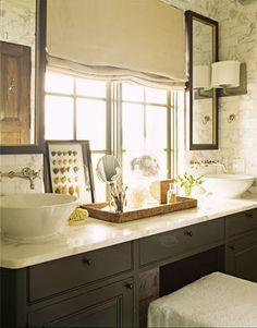 Traditional Warmth and Luxury                                                          Bobby McAlpine and Susan Ferrier designed this beach house with traditional style, maintaining richness and color throughout. The master bath features a symmetrical looking console, with two bowl sinks by Duravit.