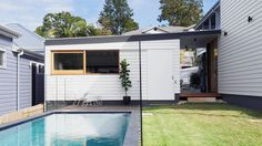 The Brisbane home of Frank Vedelago and Jane Vasey. View from the street to the front of the house with the original cottage and new carport visible. The modern addition was joined to the back of the property. Styling – Alexandra Macmillan. Photo – Mindi Cooke.