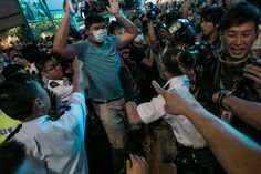 Umbrella Revolution Hong Kong, Riot police clash with protesters at Mongkok protest site after the crackdown at morning on October 17, 2014 in Hong Kong, Hong Kong. Police have begun to take measures to remove the blockades put in place by pro democracy supporters following weeks of protests. Protesters continue to call for open elections and the resignation of Hong Kong's Chief Executive Leung Chun-ying. (Photo by Lam Yik Fei/Getty Images)