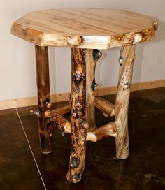 the Aspen Lodge Log Pub Table, because you have to have somewhere to set your drink before your next shot.