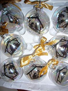 Personalized Christmas Ornaments. Just print your image onto a transparency, cut it out, roll it up and pop into a Christmas bulb. Super easy and super cute. I've used a nativity silhouette, pictures of Christ, and family pictures but the possibilities are endless.