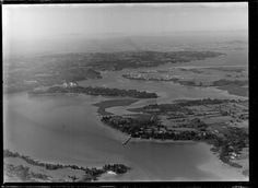 1948 aerial view from Paremoremo (bottom left) looking towards Whenuapai (bottom right) and Hobsonville. Herald Island at centre. Greenhithe top left. Whites Aviation Ltd :Photo WA-13300-G. Alexander Turnbull Library, Wellington, NZ. http://natlib.govt.nz/records/22423759