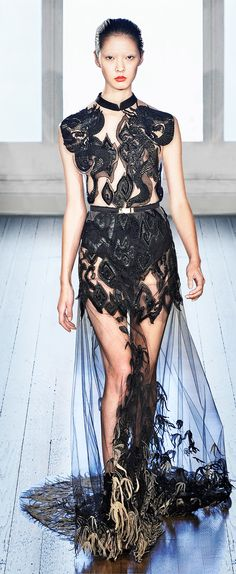 Julien Macdonald. Very different from the usual lace+transparency that has been on the runway this season..