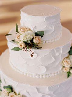 Textured white wedding cake: http://www.stylemepretty.com/new-york-weddings/rye-new-york/2017/03/16/a-romantic-seaside-wedding-for-university-sweethearts/ Photography: Charlotte Jenks Lewis - http://www.charlottejenkslewis.com/