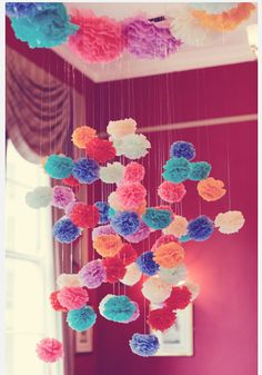 Colorful bright hues pom pom just brightens every thing - even simply looking at them through a photo! I think this would be perfect for a wedding reception or photo back -drop for pictures to add color. !