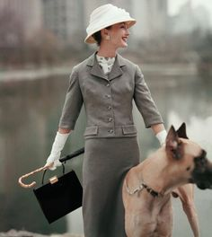 Girl and big dog, Vogue US, 1956
