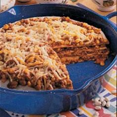 Chuck Wagon Tortilla Stack    Ingredients  1 pound ground beef  2 to 3 garlic cloves, minced  1 can (16 ounces) baked beans  1 can (14-1/2 ounces) stewed tomatoes, undrained  1 can (11 ounces) whole kernel corn, drained  1 can (4 ounces) chopped green chilies  1/4 cup barbecue sauce  4-1/2 teaspoons chili powder  1-1/2 teaspoons ground cumin  4 flo