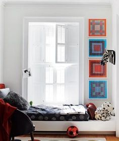 Fill a Vertical Space With Colorful Framed Fabric | Been meaning to deal with your bare walls forever, but stuck on the what, where, and how? Try these unexpected, picture-perfect plans to brighten all your blank spots.