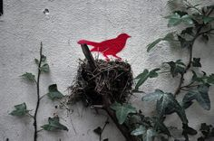 A bird in the hand....A bird in the bush. A painted bird in a nest :-)