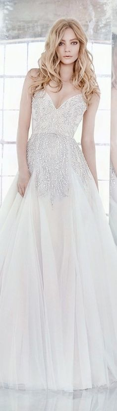 Hayley Paige Bridal Spring 2016 Comet Orchid tulle modified A-line bridal gown, rhinestone-encrusted beadwork throughout with alabaster and hologram accent, sweetheart neckline and beaded straps, full skirt with tulle godets.