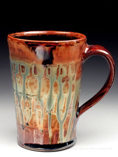 Joey Sheehan creates fluid, lively pottery enhanced with rhythmic slip and intense ash glazing.  Gorgeous.