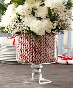 Fresh flowers in candy cane arrangement in clear glass trifle server. Makes for a lovely centerpiece.